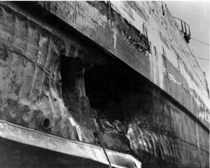 Photograph of torpedo damage below armor belt of USS             California