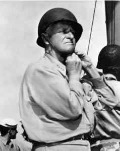 Photograph of Admiral Chester Nimitz         donning a helmet