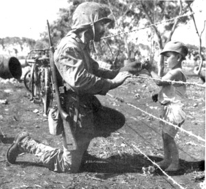 Photograph of Marine giving candy to an interned child