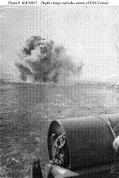 Photograph of depth charge explosion, with a second depth charge in the foreground.