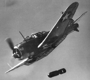 Photograph of Dauntless dive bomber dropping a bomb