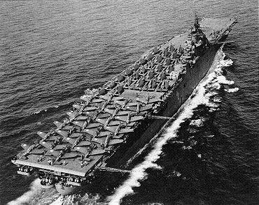 Photograph of Essex-class carrier with full deck load