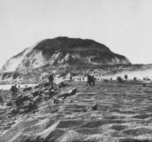 Photograph of Mount Suribachi looming over the landing beaches