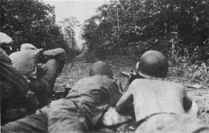 Photograph of U.S. troops advancing up the Sayre Highway outside Kabacan
