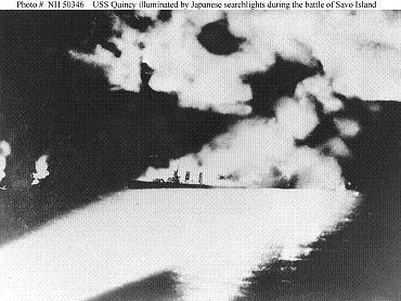 USS         Quincy illuminated by Japanese searchlights at the Battle of         Savo Island